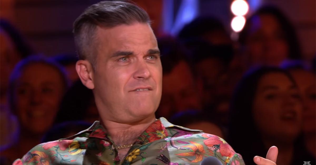 Robbie Williams apprezza troppo l'esibizione, la moglie lo fulmina